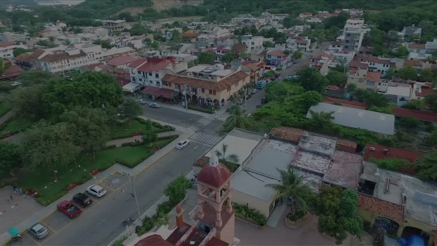 Aerial view of the central park of Huatulco, Oaxaca, Mexico. The city is La Crucecita downtown, poblational center of the resort The camera turns 360 around the tower of the Virgin of Guadalupe Church