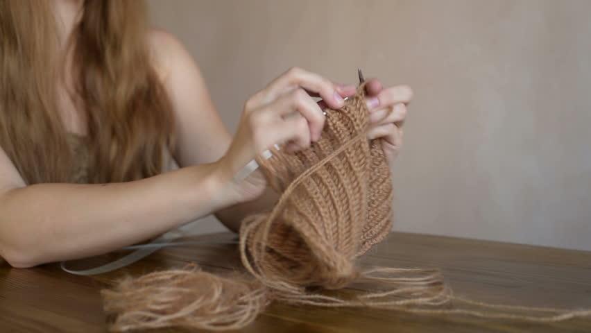 Blonde woman knitting