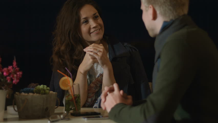 Happy young man and woman having interesting conversation, talking on date