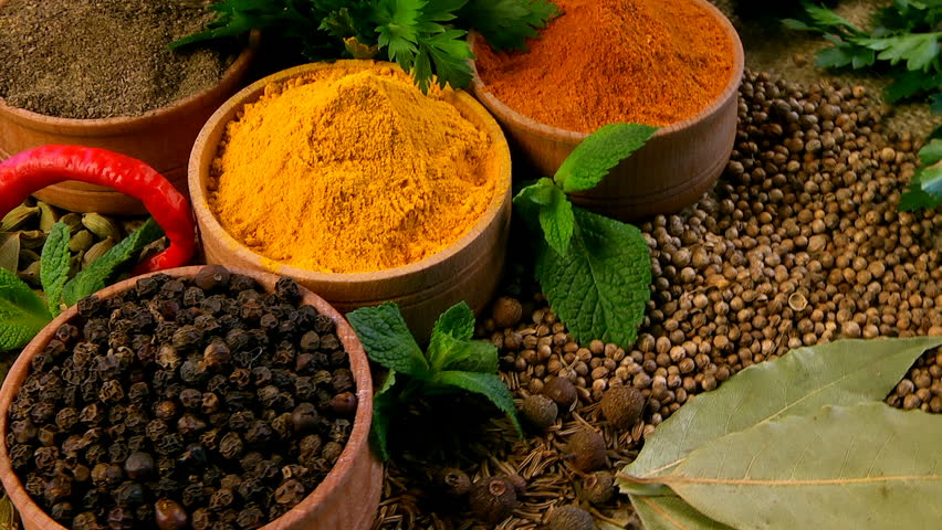 A mixture of spices. Pepper, cardamom, cloves, cumin, cilantro, coriander, bay leaf, turmeric