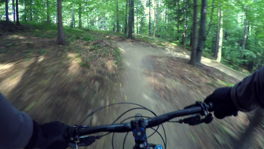 Downhill on mountain bike POV rider On Dirt Trail