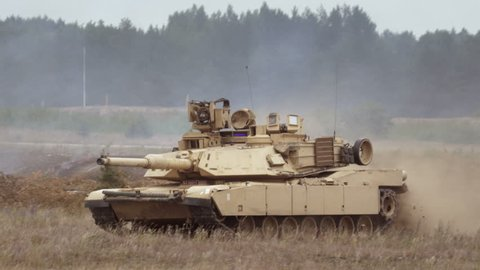 GAIZIUNAI, LITHUANIA - JUNE 18, 2015: Tank drives on the battlefield. Close-up of M1A2 Abrams during NATO exercise Saber Strike 2015.