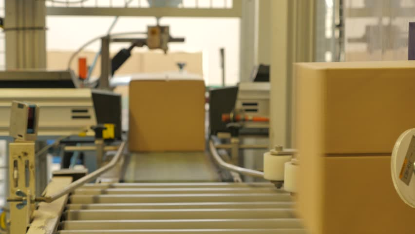 Cardboard boxes picked up by a robot arm in a rice factory 4K | Shutterstock HD Video #20024620