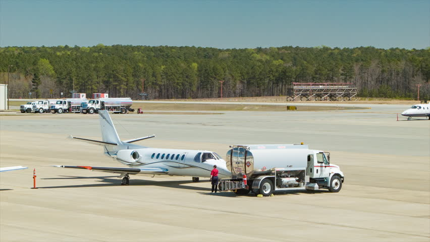 RALEIGH, NC - 2016: Generic Business Jet Refueled by Jet Fuel Gas Truck at the Raleigh-Durham International RDU Airport Private Aviation Platform on a Sunny Day in the Research Triangle North Carolina