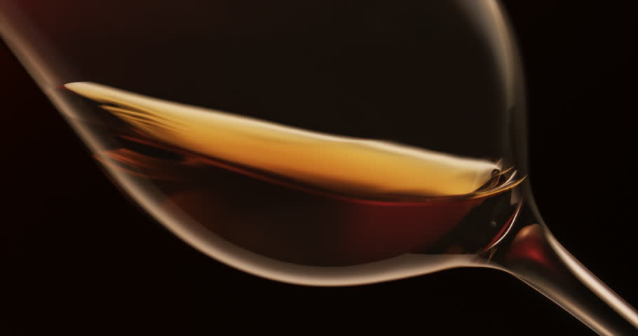Whisky or whiskey swirling in glass on black background | Shutterstock HD Video #20099179
