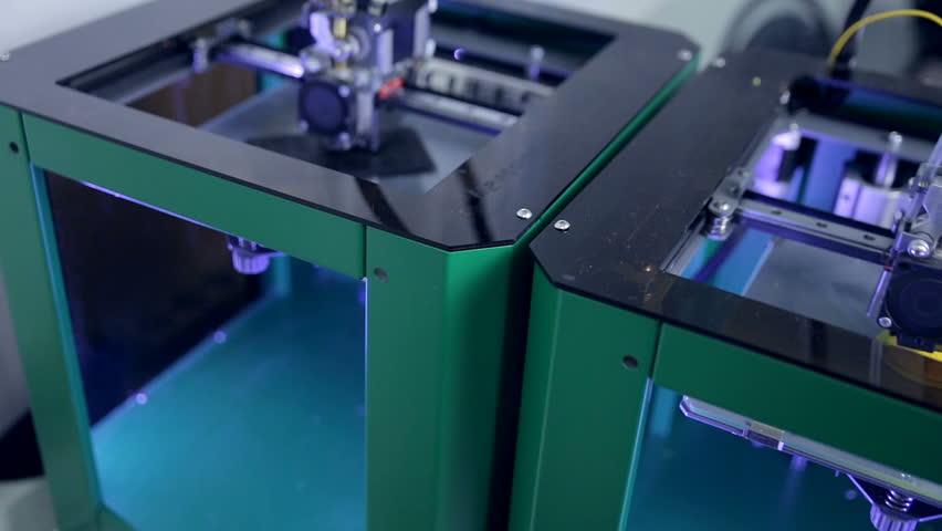 Three dimensional printer making industrial use nut. 3D plastic printing modern technology.