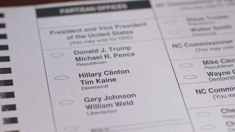 ASHEVILLE, NC - CIRCA OCTOBER 2016 - Close up a voter voting for the democrat Hillary Clinton and Tim Kaine with a black pen during the 2016 General Presidential Election