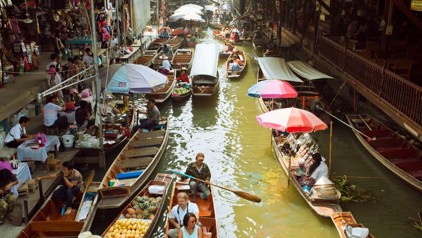 DAMNOEN SADUAK, THAILAND - FEBRUARY 25: Tourists are doing boat rides at the