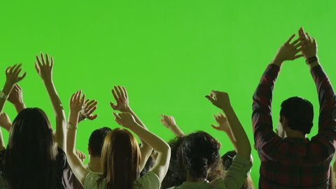 Crowd of fans dancing on green screen. Concert, Jumping, Dancing, Hands up. Slow motion. Shot on RED EPIC Cinema Camera