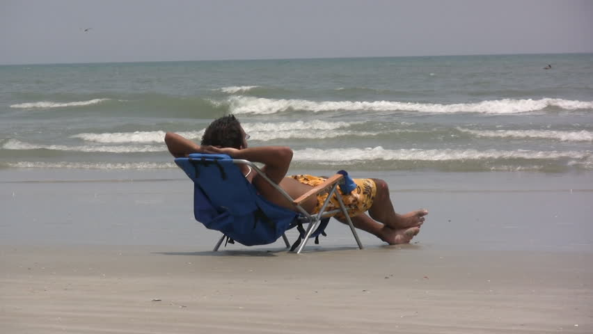 Guy In Beach Chair Stock Footage Video 100 Royalty Free 202030 Shutterstock