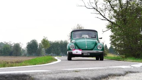 MILAN / ITALY - OCTOBER 01, 2016: a vintage Volkswagen Beetle traveling in the countryside during the Trofeomilano, a meeting of vintage cars. This car was manufactured from 1938 until 2003.