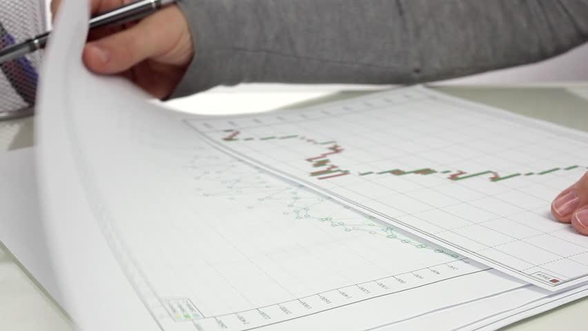 Businesswoman performs analysis of financial statements. Close up/Analysis of Financial Statements | Shutterstock HD Video #20240122