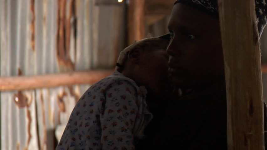 KENYA - CIRCA 2006: Silhouette of unidentified girl and her baby circa 2006 in Kenya. | Shutterstock HD Video #2024518