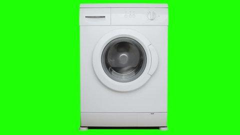 Washing machine. Process of washing. Green screen.