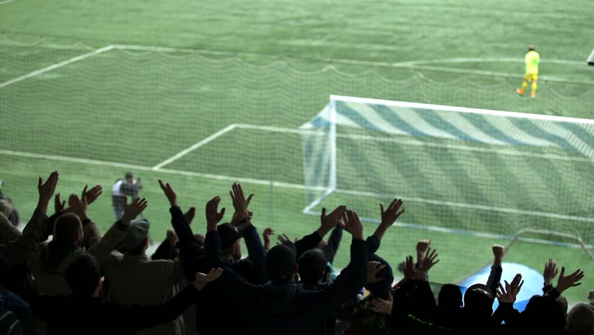 Fans are chanting at a football stadium. | Shutterstock HD Video #20272390