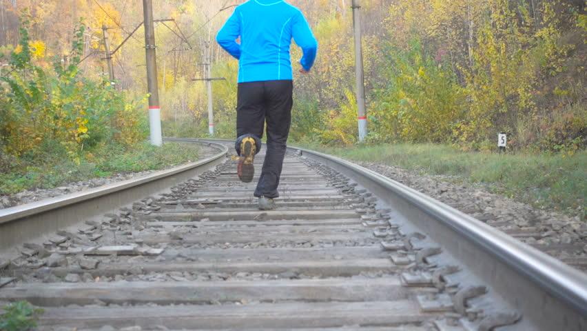 Feet Of Six Half-Naked Men Running At Autumn On Old Railway Stock Footage Video -1624