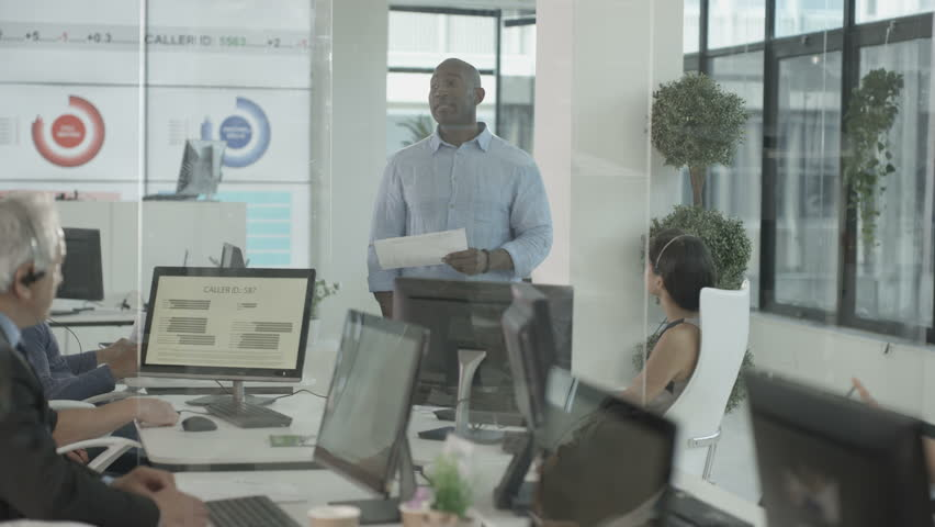 4K Business manager talking to his employees in busy modern call centre. Shot on RED Epic. | Shutterstock HD Video #20343220
