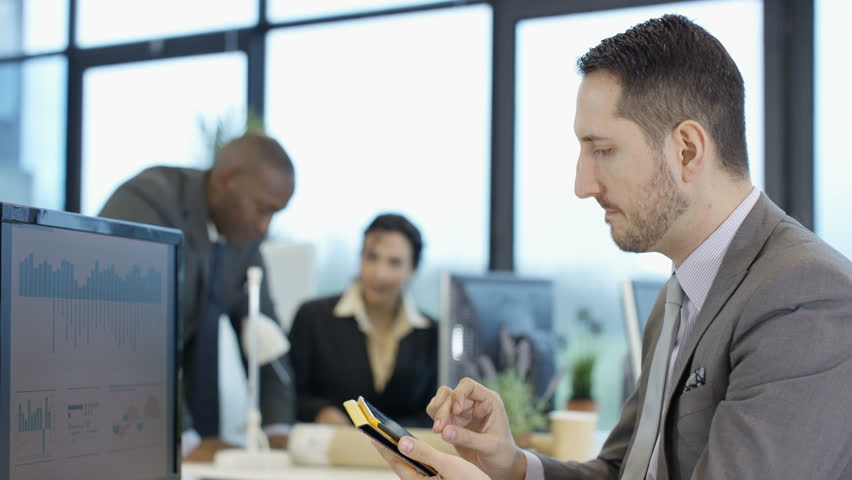4K Stressed businessman in city office, looking at computer tablet & talking to colleagues. Shot on RED Epic. | Shutterstock HD Video #20350060