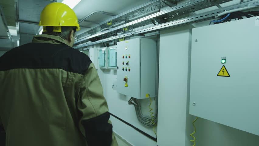 man doing electrical metering equipment