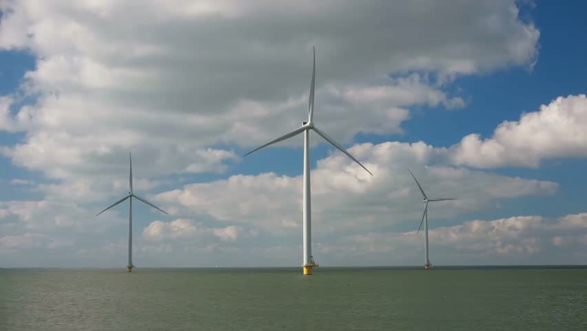 Three isolated offshore windmills at windmill farm ,Westermeerwind Wind Farm is a wind farm for and by the polder, and will provide 160,000 households,Urk Flevoland Netherlands August 2016