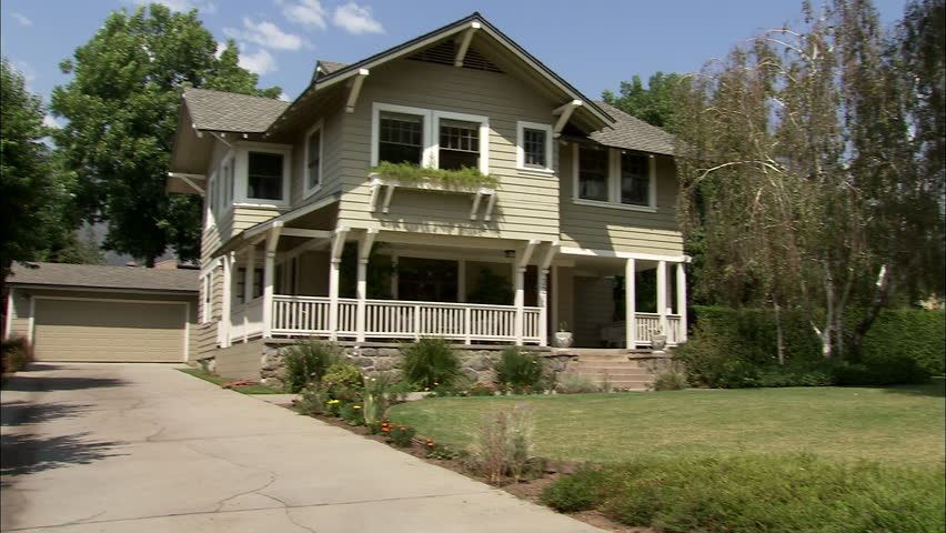 Day Low Angle Wide Pan Left Right Aked Two Story Brown Wood Clapboard Craftsman Style