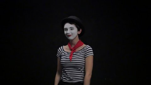 Mime girl talking on the phone. 4k