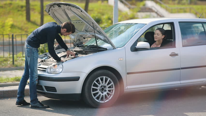 Woman help to man repair broken car