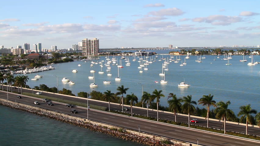 sailboats in miami bay area on a beautiful summer day, aerial view