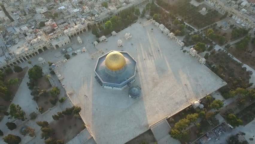 Aerial view of Temple mount mosque at Jerusalem, Israel- Palestine Epic evening shot of the Dome of the Rock on Temple mount while tilt up to the Jerusalem old city Sun flare in frame