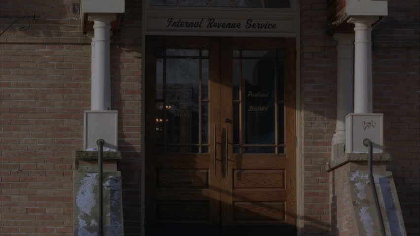 Day Tight Entrance Small Red Brick Government Building Arched Window Above  Door Reads Internal Revenue Service