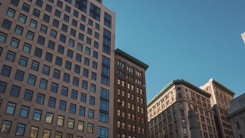 NEW YORK CITY - OCTOBER 07 (TIMELAPSE): Hyperlapse walk on 5th Ave of Manhattan buildings on blue sky background on October 07, 2016 in New York, USA.