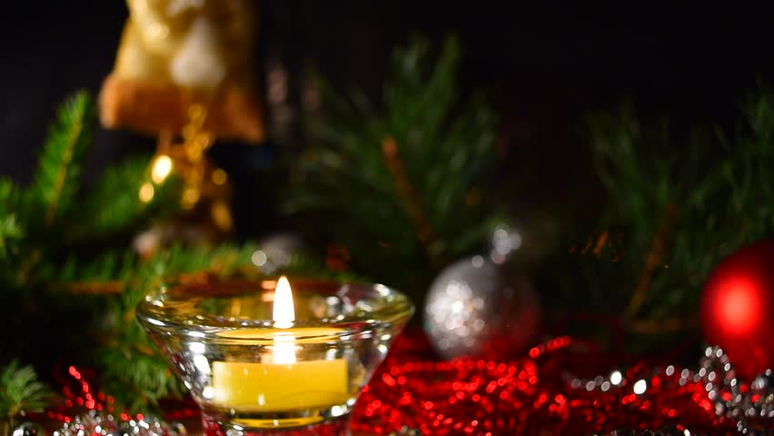 Christmas celebration background. Christmas, advent collage with tree branches, candle, christmas balls and decoration. Candle light closeup at background of christmas decoration. #20626222