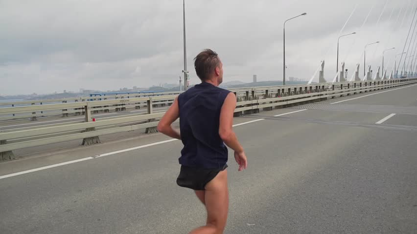 Athlete on marathon race running on a bridge. slow motion | Shutterstock HD Video #20637040