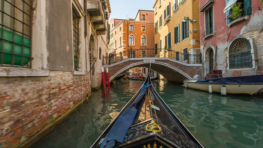 VENICE, ITALY - SEPTEMBER 09, 2016: In gondola on the canals of Venice, Italy