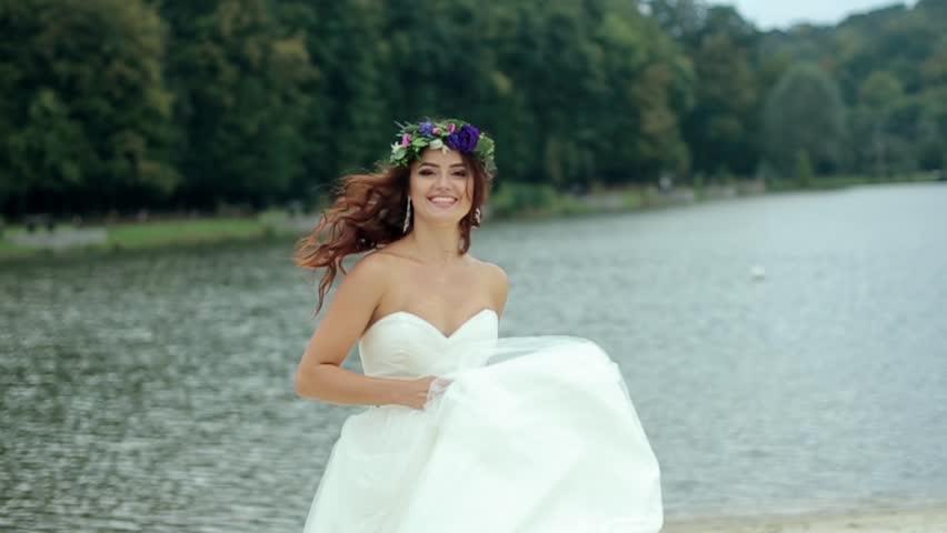 Stock video of happy bride in wedding dress turns | 20663560 ...