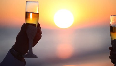 Celebration toast with champagne at the sea background