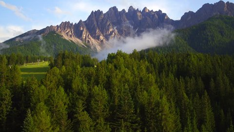 Mountain view , a suggestive aerial video in mountain over a forest in a beautiful summer day, dolomiti
