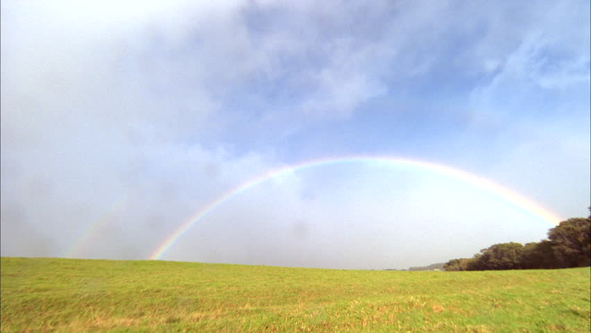 Day Timelapse Rainbow clouds over green field prairie Drops rain lens Green trees background | Shutterstock HD Video #20718292