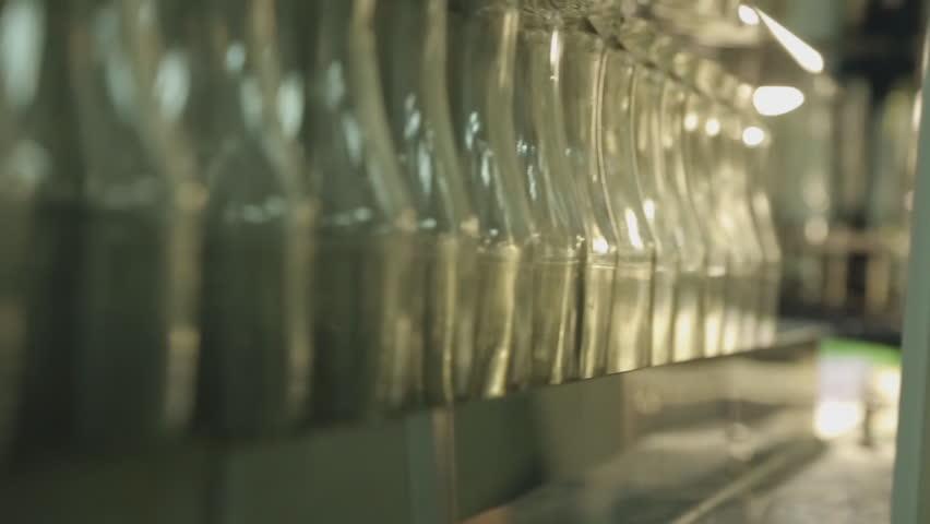 Jars of orange liquid arranged in manufacturing plant | Shutterstock HD Video #20757250