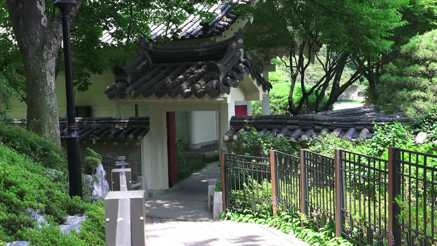 Asian Gateway On Forest Path At The Chungnyeolsa Shrine, Busan, South Korea  July 21