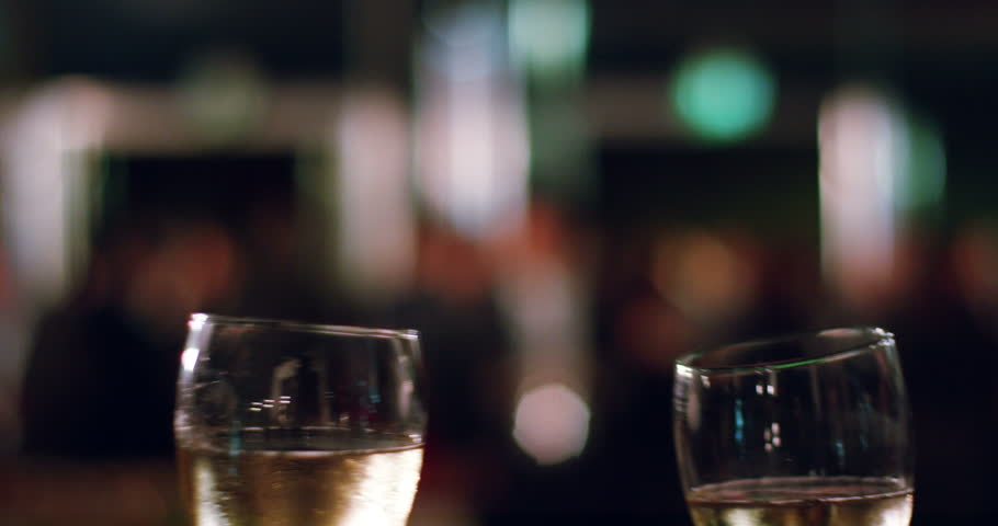Two people toasting with a glass of champagne in a party to celebrate with cheers at the birthday party or business hiring. Concept: party, birthday, wine, business and success.