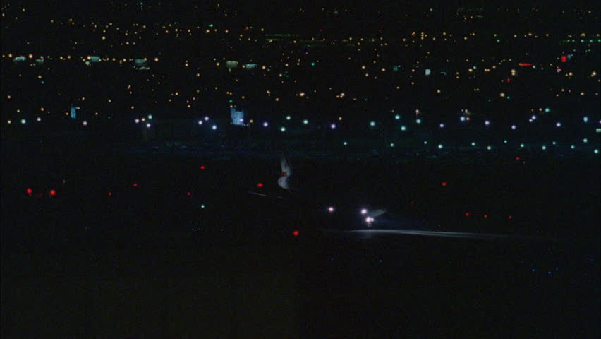 Night High Angle Commercial Plane Down Runway Slow 1st Picks Up Speed Taking Takes