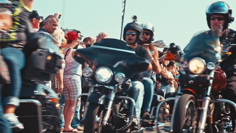 Motorcycle convoi at a biker parade cruising down the road / Europe's biggest Harley Davidson event 6-11 September 2016 (Faaker See/AUT) 4K editorial footage