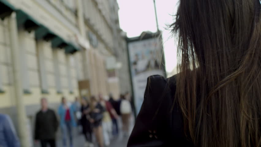 Girl goes on a street | Shutterstock HD Video #20863660