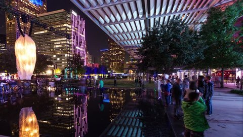 Dallas night life with skyline reflections - Panning time-lapse in Arts District