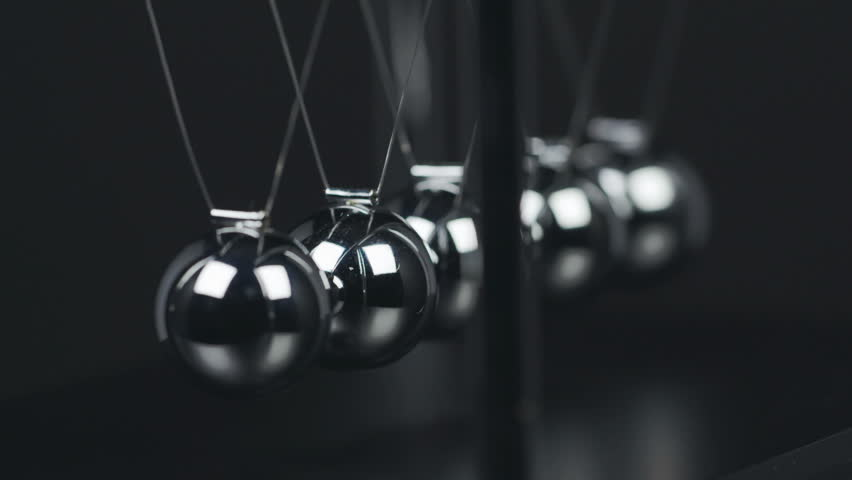 Slow motion shot of a Newton's Cradle.