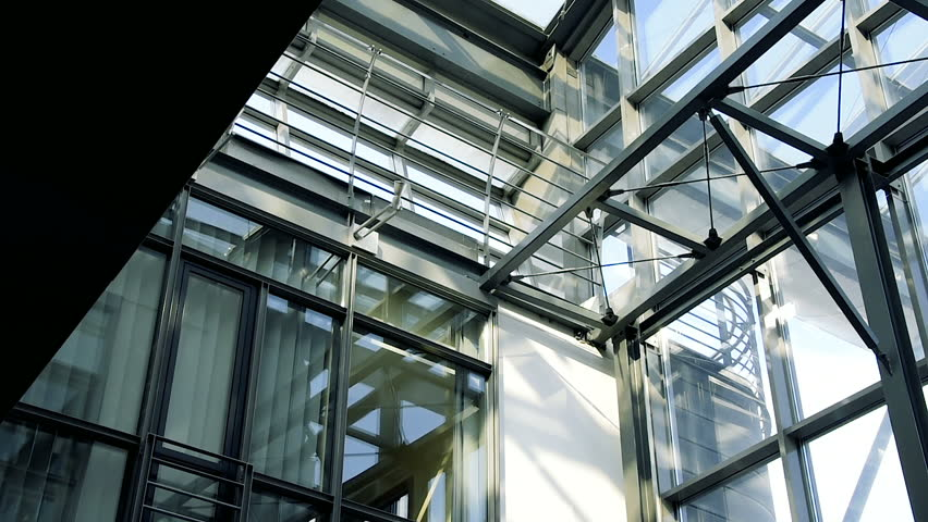 Modern Architecture Detail curves and steel architecture of a building entrance pan across