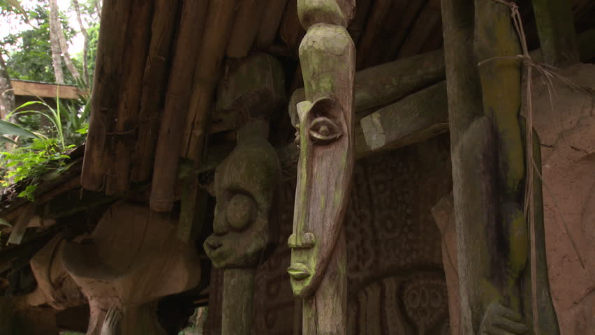 Osogbo, Nigeria - August 2013;Carved faces at entrance of pavilion