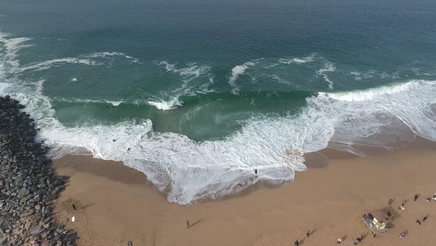 Aerial video above the Newport Beach famous wedge, famous for surfers and body boarders.