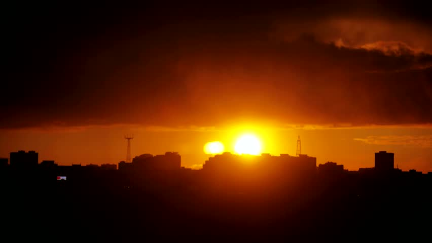 Timelapse of gorgeous sunset over silhouette city skyline. 3840x2160 | Shutterstock HD Video #20976490